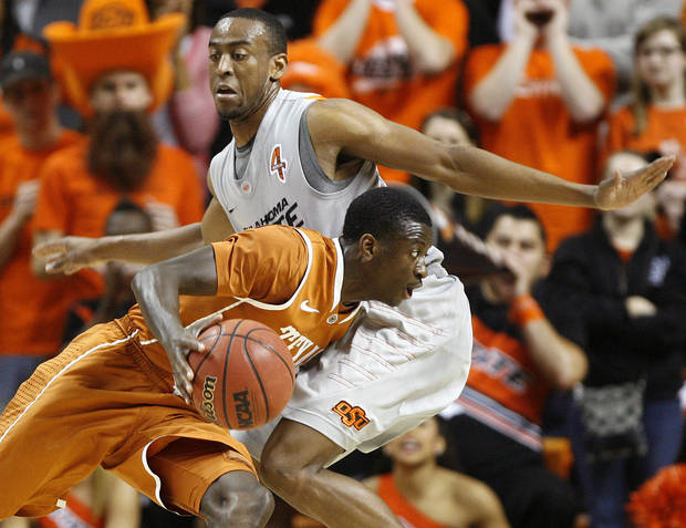 Texas' Myck Kabongo (12) tries to get past Oklahoma State's Markel Brown (22) during an NCAA college basketball game between Oklahoma State University (OSU) and the University of Texas (UT) at Gallagher-Iba Arena in Stillwater, Okla., Saturday, Feb. 18, 2012. Oklahoma State won 90-78. Photo by Bryan Terry, The Oklahoman