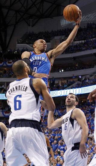 Oklahoma City's Russell Westbrook (0) goes past Tyson Chandler (6) of Dallas during game 2 of the Western Conference Finals in the NBA basketball playoffs between the Dallas Mavericks and the Oklahoma City Thunder at American Airlines Center in Dallas, Thursday, May 19, 2011. Photo by Bryan Terry, The Oklahoman