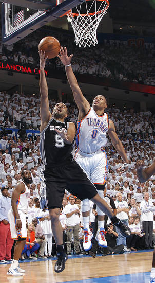 Oklahoma City's Russell Westbrook (0) defends on San Antonio's Tony Parker (9) during Game 6 of the Western Conference Finals between the Oklahoma City Thunder and the San Antonio Spurs in the NBA playoffs at the Chesapeake Energy Arena in Oklahoma City, Wednesday, June 6, 2012. Photo by Chris Landsberger, The Oklahoman