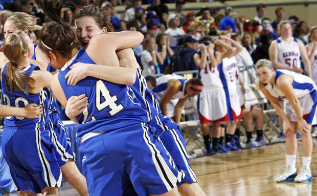 The Lomega Raiderettes celebrate in front of the Hammon Lady Warriors after the Class B girls state championship high school basketball game between Hammon and Lomega at State Fair Arena in Oklahoma City, Saturday, March 3, 2012. Lomega won, 49-44. Photo by Nate Billings, The Oklahoman