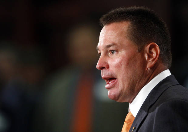 Butch Jones, Tennessee's new head football coach, speaks during an NCAA college football new conference on Friday, Dec. 7, 2012, in Knoxville, Tenn. The Vols' introduced Jones on Friday as its successor to Derek Dooley, who was fired Nov. 18 after going 15-21 in three seasons. (AP Photo/Wade Payne)