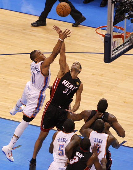 Oklahoma City's Russell Westbrook (0) shoots over Miami's Shane Battier (31) during Game 2 of the NBA Finals between the Oklahoma City Thunder and the Miami Heat at Chesapeake Energy Arena in Oklahoma City, Thursday, June 14, 2012. Photo by Bryan Terry, The Oklahoman