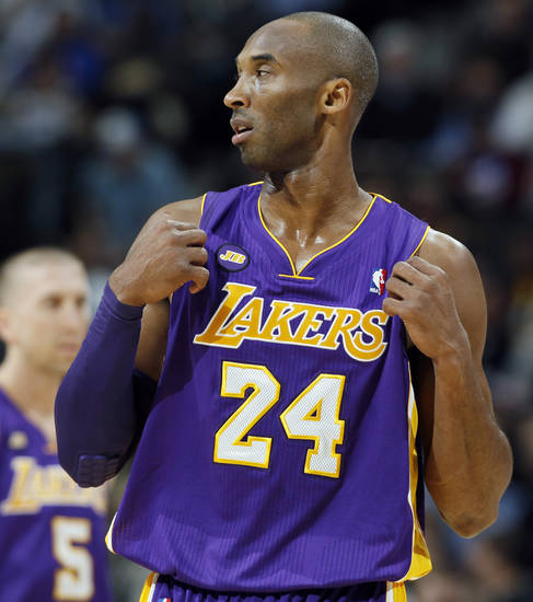 Los Angeles Lakers guard Kobe Bryant adjusts his jersey after being called for a foul against the Denver Nuggets in the first quarter of an NBA basketball game in Denver on Monday, Feb. 25, 2013. (AP Photo/David Zalubowski)