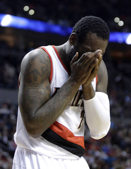 Portland Trail Blazers center J.J. Hickson reacts after he is called for a foul  during the second half of an NBA basketball game against the Phoenix Suns in Portland, Ore., Tuesday, Feb. 19, 2013.  Phoenix beat Portland 102-98.(AP Photo/Don Ryan)