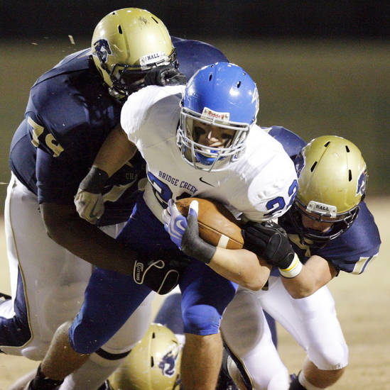 Jarred Stewart (79), left, and Cale Courtney (11), right, of Heritage Hall stop Blake Henderson (22) of Bridge Creek during the high school football playoff game between Bridge Creek and Heritage Hall at Heritage Hall School in Oklahoma City, Friday, Nov. 19, 2010. Photo by Nate Billings, The Oklahoman