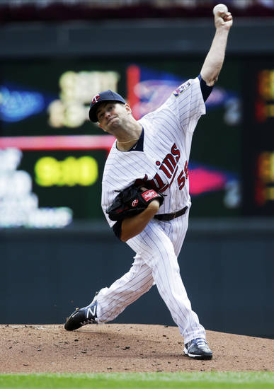 Minnesota Twins pitcher Scott Diamond throws against the Oakland Athletics in the first inning of a baseball game, Thursday, Sept. 12, 2013 in Minneapolis. (AP Photo/Jim Mone)