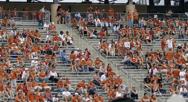 Longhorn fans clear the stands early in the 63-21 loss to Oklahoma during the Red River Rivalry college football game between the University of Oklahoma (OU) and the University of Texas (UT) at the Cotton Bowl in Dallas, Saturday, Oct. 13, 2012. Photo by Chris Landsberger, The Oklahoman