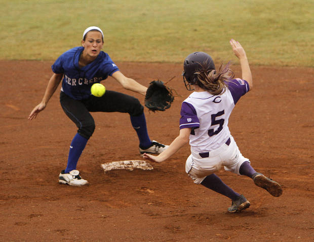 Chickasha's Karlye Weber (5) slides into second past Deer Creek's Kelsi Williams (8) during a 5A state softball semifinals game between Edmond North and Yukon at ASA Hall of Fame Stadium in Oklahoma City, Okla., Friday, Oct. 12, 2012.  Photo by Garett Fisbeck, The Oklahoman