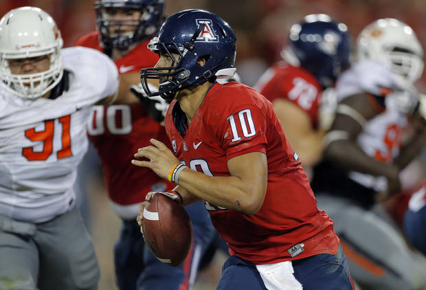 Arizona's Matt Scott (10) rushes during the college football game between the University  of Arizona and Oklahoma State University at Arizona Stadium in Tucson, Ariz.,  Sunday, Sept. 9, 2012. Photo by Sarah Phipps, The Oklahoman