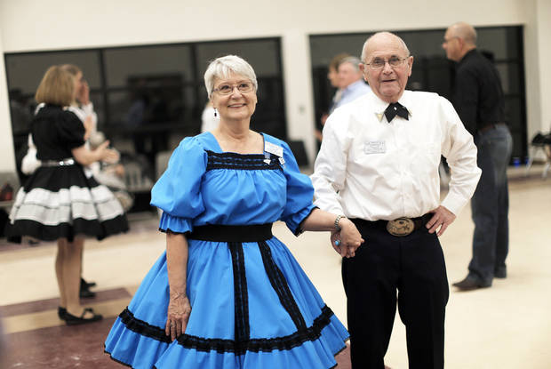 Jacque Wilson and Bill Stephens prepare to dance at a Teacup Chains Square Dance Club open house.