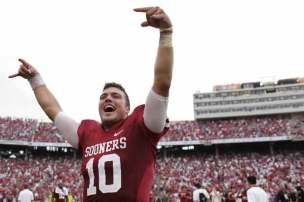 Oklahoma quarterback Blake Bell celebrates after their 63-21 win over Texas on Saturday, Oct. 13, 2012 in Dallas, Texas. (AP Photo/The Daily Texan, Lawrence Peart)
