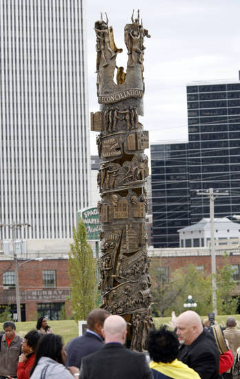 The centerpiece of the John Hope Franklin Reconciliation park depicts scenes from the race riots and other key parts of Oklahoma history.  PHOTO BY CORY YOUNG, TULSA WORLD