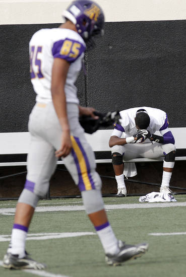 Anadarko's Malik Boardinham (85) and Mykel Shaw (7) react after the 21-14 loss to Clinton during the Class 4A Oklahoma state championship football game between Anadarko and Clinton at Boone Pickens Stadium on Saturday, Dec. 1, 2012, in Stillwater, Okla.   Photo by Chris Landsberger, The Oklahoman