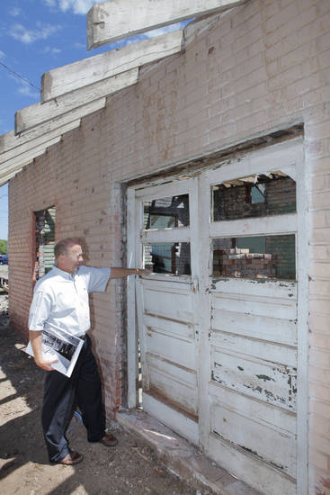 Barry Rice looks at the doors of the old interurban depot in downtown Edmond. BY DAVID MCDANIEL, THE OKLAHOMAN <strong>David McDaniel - The Oklahoman</strong>