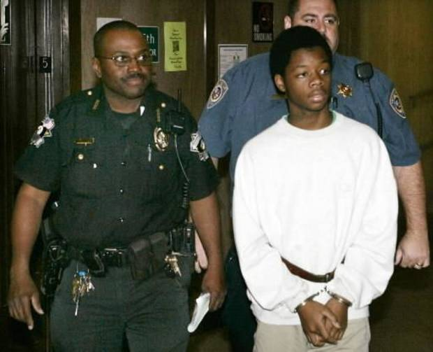 Jevontai Ingram is taken into Judge Fred Doak's courtroom in the Oklahoma County Courthouse in Oklahoma City, Oklahoma September 25, 2009. Photo by Steve Gooch,