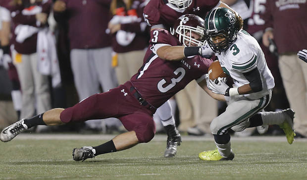 Jenks&#039; Kent Clark (3) stops Norman North&#039;s Bryan Payne (3) during the Class 6A Oklahoma state championship football game between Norman North High School and Jenks High School at Boone Pickens Stadium on Friday, Nov. 30, 2012, in Stillwater, Okla.   Photo by Chris Landsberger, The Oklahoman