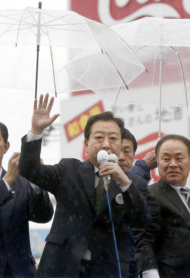 Prime Minister Yoshihiko Noda of the ruling Democratic Party of Japan delivers his speech during parliamentary elections campaign in Iwaki, Fukushima Prefecture, Japan, Tuesday, Dec. 4, 2012. Leaders for Japan's biggest political parties are kicking off the campaign for parliamentary elections to be held in less than two weeks with visits to nuclear crisis-hit Fukushima prefecture. (AP Photo/Kyodo News) JAPAN OUT, MANDATORY CREDIT, NO LICENSING IN CHINA, FRANCE, HONG KONG, JAPAN AND SOUTH KOREA
