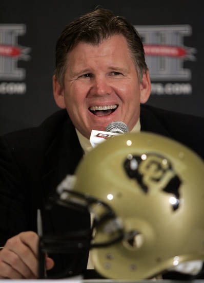 Colorado head football coach Dan Hawkins talks with reporters at Big 12 media day in Irving, Texas, on Wednesday, July 28, 2010.  (AP Photo/Mike Fuentes) ORG XMIT: TXMF104