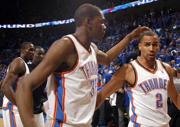 Oklahoma City's Kevin Durant (35) and Thabo Sefolosha (2) celebrate following the first round NBA basketball playoff game between the Oklahoma City Thunder and the Denver Nuggets on Wednesday, April 20, 2011, at the Oklahoma City Arena. Photo by Sarah Phipps, The Oklahoman