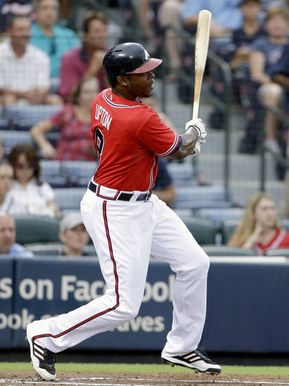 Atlanta Braves' Justin Upton hits a single to score teammate Jason Heyward, not pictured, in the first inning of a baseball game against the Arizona Diamondbacks, Friday, June 28, 2013, in Atlanta. (AP Photo/David Goldman)