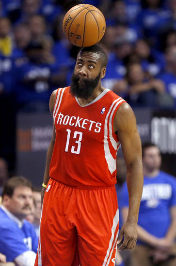 Houston's James Harden (13) balances the ball on his head during Game 1 in the first round of the NBA playoffs between the Oklahoma City Thunder and the Houston Rockets at Chesapeake Energy Arena in Oklahoma City, Sunday, April 21, 2013. Photo by Sarah Phipps, The Oklahoman