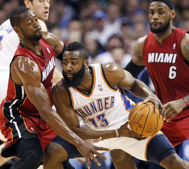 Miami's Dwyane Wade (3) defends Oklahoma City's James Harden (13) near Miami's LeBron James (6) during the NBA basketball game between the Miami Heat and the Oklahoma City Thunder at Chesapeake Energy Arena in Oklahoma City, Sunday, March 25, 2012. Photo by Nate Billings, The Oklahoman