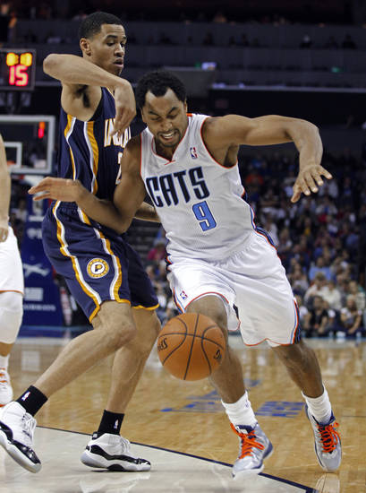 Charlotte Bobcats' Gerald Henderson, right, is fouled by Indiana Pacers' Gerald Green, left, during the second half of an NBA basketball game in Charlotte, N.C., Friday, Nov. 2, 2012. The Bobcats won 90-89. (AP Photo/Chuck Burton)