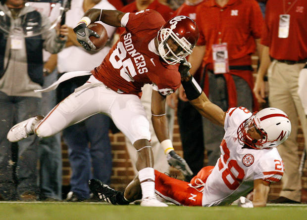 Oklahoma's Ryan Broyles (85) is drug down by Nebraska's Eric Hagg (28) during the first half of the college football game between the University of Oklahoma Sooners (OU) and the University of Nebraska Huskers (NU) at the Gaylord Family Memorial Stadium, on Saturday, Nov. 1, 2008, in Norman, Okla. 