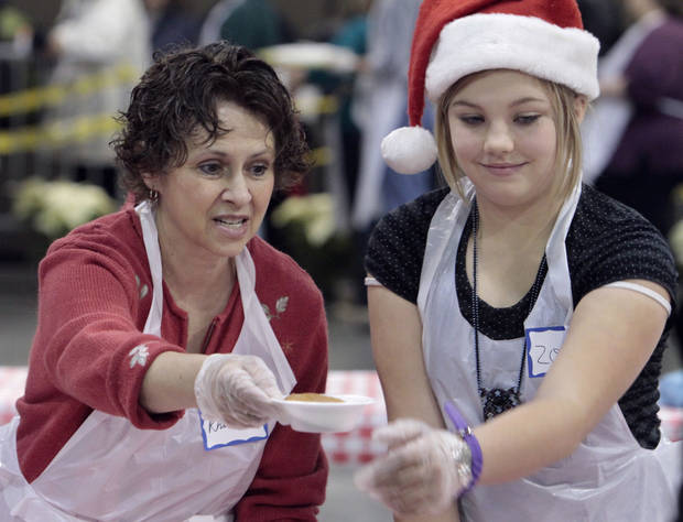 Above: Volunteers Rhonda Bingaman and Zoe Vernon pass out dessert during the 2011 Red Andrews Christmas Dinner in Oklahoma City.