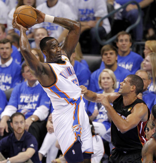 Oklahoma City's Kendrick Perkins (5) tries to pass around Miami's Shane Battier (31) during Game 2 of the NBA Finals between the Oklahoma City Thunder and the Miami Heat at Chesapeake Energy Arena in Oklahoma City, Thursday, June 14, 2012. Photo by Chris Landsberger, The Oklahoman