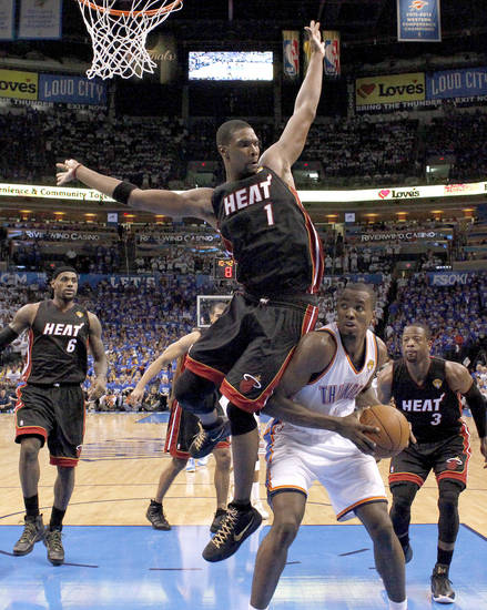 Oklahoma City�s Serge Ibaka, right, is defended by Miami�s Chris Bosh during the Heat�s 100-96 victory on Tuesday. Photo by Sarah Phipps, The Oklahoman