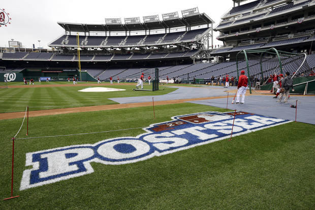 Washington Nationals players take batting practice at Nationals Park, Tuesday, Oct. 9, 2012, in Washington. The Nationals are scheduled to host the St. Louis Cardinals in Game 3 of the National League division series on Wednesday. The best-of-five games series is tied 1-1. (AP Photo/Alex Brandon)