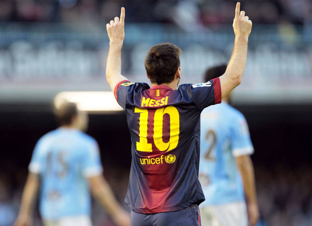 FC Barcelona's Lionel Messi from Argentina, celebrates after scoring the second goal against RC Celta during a Spanish La Liga soccer match at the Balaidos stadium in Vigo, Spain, Saturday, March 30, 2013. (AP Photo/Lalo R. Villar)