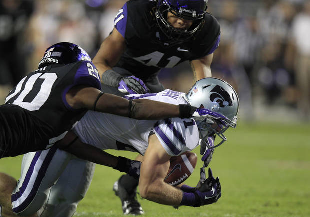 Kansas State linebacker Jonathan Truman (21) recovers a fumble against TCU's Deante' Gray (20) and Jonathan Anderson (41) during the first half of an NCAA college football game, Saturday, Nov. 10, 2012, in Fort Worth, Texas. (AP Photo/LM Otero)