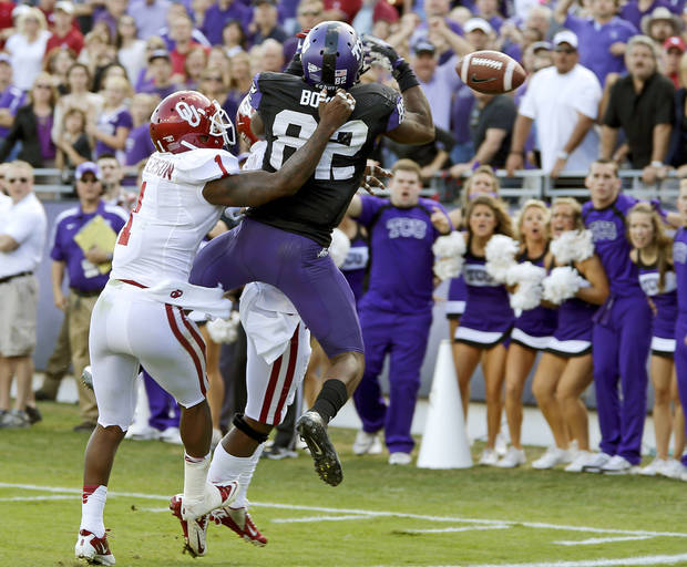 Oklahoma&#039;s Tony Jefferson (1) defends TCU&#039;s Josh Boyce (82) on a pass attempt in the final seconds of the college football game between the University of Oklahoma Sooners (OU) and the Texas Christian University Horned Frogs (TCU) at Amon G. Carter Stadium in Fort Worth, Texas, Saturday, Dec. 1, 2012. Oklahoma won 24-17. Photo by Bryan Terry, The Oklahoman