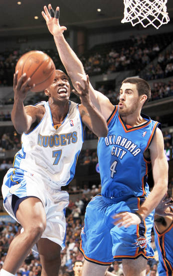 Nuggets guard Chauncey Billups, left, drives the lane for a shot against the Thunder's Nick Collison.  AP Photo