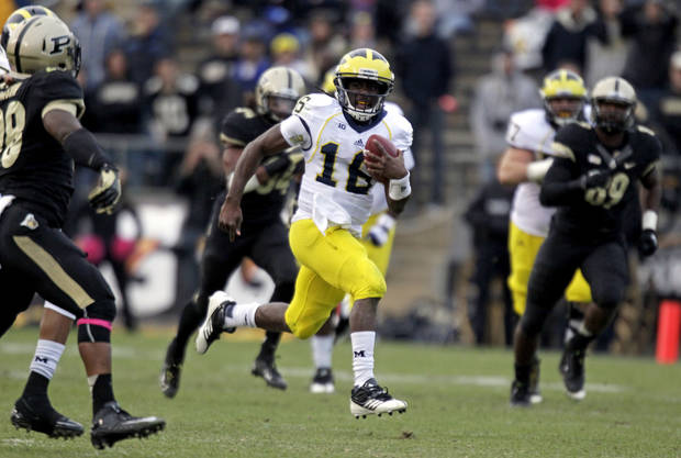 Michigan quarterback Denard Robinson takes off on a 59-yard gain against Purdue during the second half of an NCAA college football game in West Lafayette, Ind., Saturday, Oct. 6, 2012. Michigan defeated Purdue 44-13. (AP Photo/Michael Conroy)