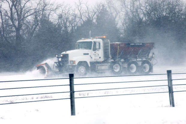 A snow plow makes its way east on I-44 during a major winter storm that hit central Oklahoma Tuesday, Feb. 1, 2011. Photo by Doug Hoke, The Oklahoman.