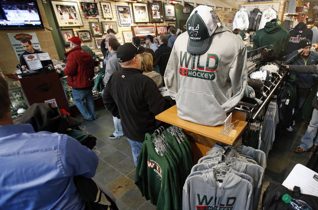 Minnesota Wild NHL hockey fans took advantage of a one-day, 50 percent off sale of Wild-related merchandise at the team's hockey lodge store Wednesday, Jan. 16, 2013, in St. Paul, Minn. The Wild play their home opener Saturday against the Colorado Avalanche. (AP Photo/Jim Mone)