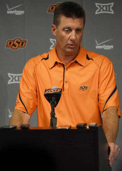 Oklahoma State football coach Mike Gundy addresses media members at a media availability session inside Gallagher-Iba Arena on Thursday, August 21, 2014. Photo by KT King/For the Oklahoman