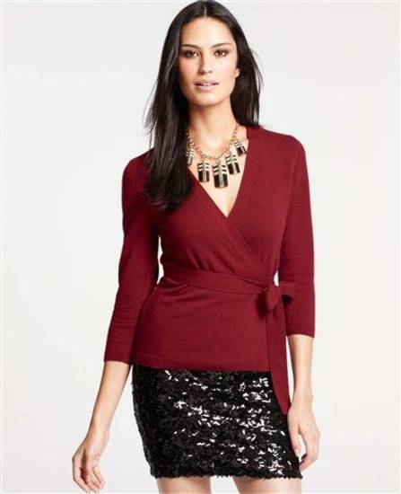 This undated product image released by Ann Taylor shows a model wearing a cashmere wrap cardigan sweater and black sequin miniskirt. (AP Photo/Ann Taylor)