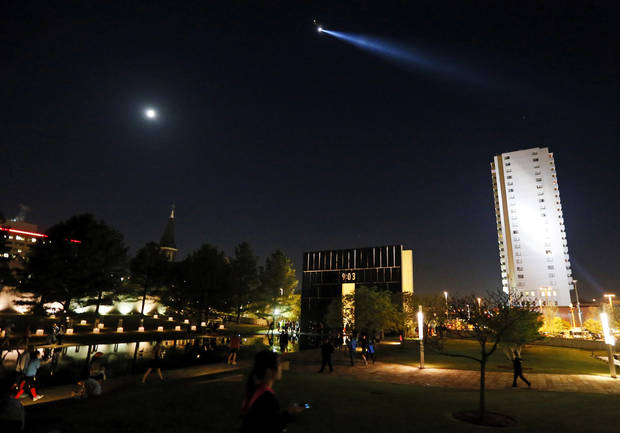 A helicopter shines a searchlight over the Oklahoma City National Memorial before the Oklahoma City Memorial Marathon in Oklahoma City, Sunday, April 28, 2013. Photo by Nate Billings, The Oklahoman