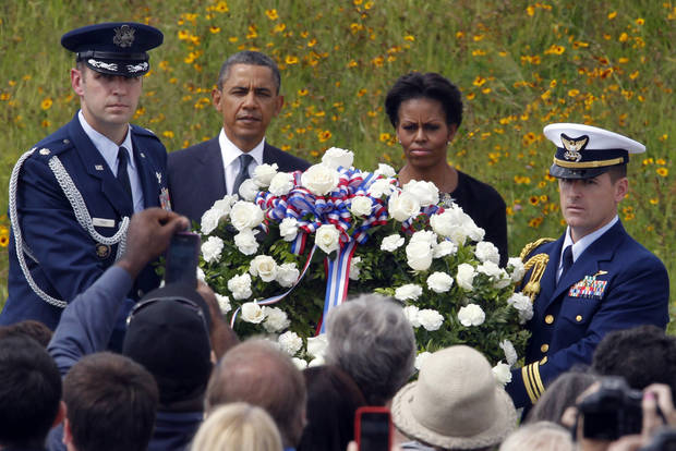 President Barack Obama and first lady Michelle Obama lay a wreath at the Wall of Names at phase 1 of the permanent Flight 93 National Memorial near the crash site of Flight 93 in Shanksville, Pa. Sunday Sept. 11, 2011. (AP Photo/Gene J. Puskar)