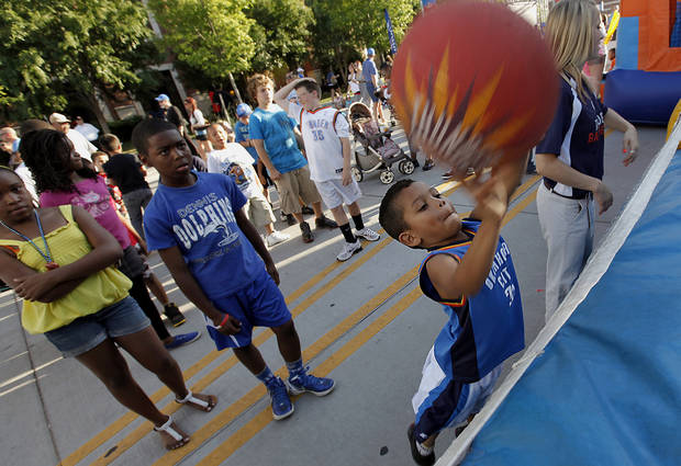 Adrian Martinez, 5, takes a shot while having fun in Thunder Alley before the start of Game 2 in the second round of the NBA playoffs between the Oklahoma City Thunder and the L.A. Lakers at Chesapeake Energy Arena on Wednesday,  May 16, 2012, in Oklahoma City, Oklahoma. Photo by Chris Landsberger, The Oklahoman