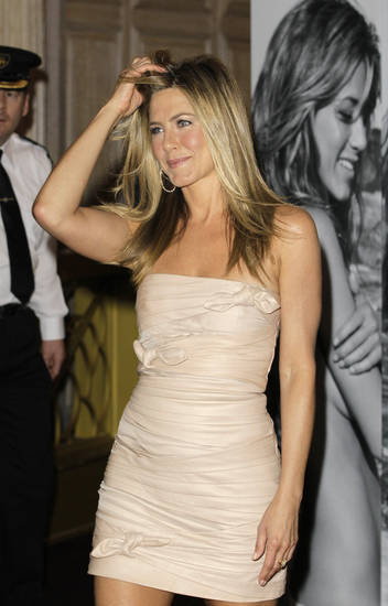 Jennifer Aniston arrives at the launch of her new perfume at a department store in London, Wednesday, July 21, 2010. (AP Photo/Kirsty Wigglesworth) ORG XMIT: LKW109