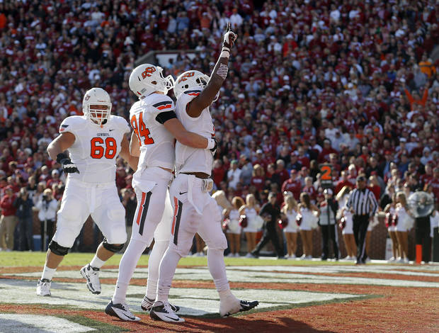 Oklahoma State's Joseph Randle (1), Austin Hays (84) and Oklahoma State's Lane Taylor (68) celebrate a Randle touchdown during the Bedlam college football game between the University of Oklahoma Sooners (OU) and the Oklahoma State University Cowboys (OSU) at Gaylord Family-Oklahoma Memorial Stadium in Norman, Okla., Saturday, Nov. 24, 2012. Photo by, Sarah Phipps The Oklahoman