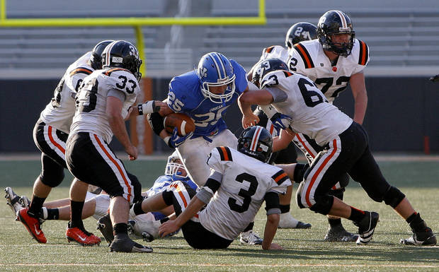 CLASS A HIGH SCHOOL FOOTBALL STATE CHAMPIONSHIP: Woodland's Tracey Wilson is stuffed by the Wayne defense during the Class A football championship football game between Woodland and Wayne at Boone Pickens Stadium in Stillwater, Okla., Saturday, Dec. 10, 2011. Photo by Sarah Phipps, The Oklahoman