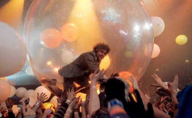 Wayne Coyne, lead singer of The Flaming Lips, crowd surfs in a translucent ball during their performance at the Cox Convention Center during Opening Night 2008 in downtown Oklahoma City, Monday, December 31, 2007. BY MATT STRASEN, THE OKLAHOMAN