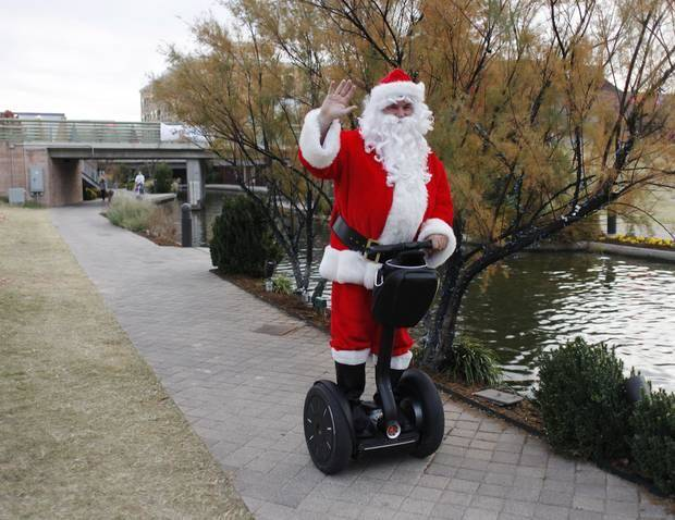 The Sonic Segway Santa cruises along the Bricktown Canal as part of Downtown in December in Oklahoma City Saturday, November 19, 2011. Photo by Doug Hoke, The Oklahoman Archives