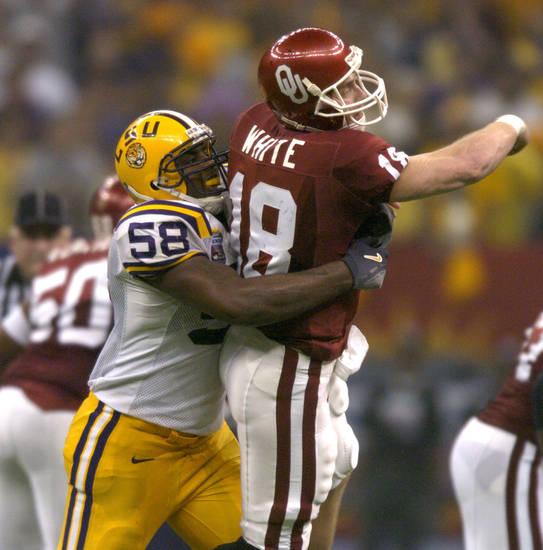 UNIVERSITY OF OKLAHOMA (OU) VS LOUISIANA STATE UNIVERSITY (LSU) COLLEGE FOOTBALL IN THE SUPERDOME NEW ORLEANS SUNDAY, JAN 4, 2003. Oklahoma's Jason White is dropped to the turf by LSU's Lionel Turner (58) after being pressured to thow under Turner's rush in the third qaurter.  Staff photo by Nate Billings